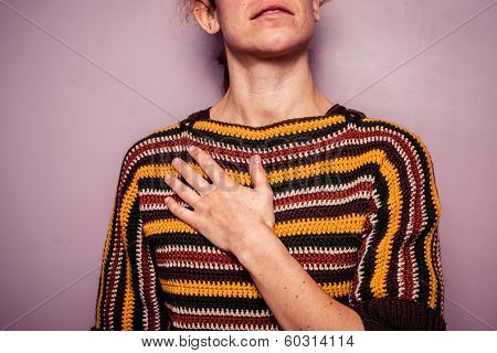 Young Woman Touching Her Chest