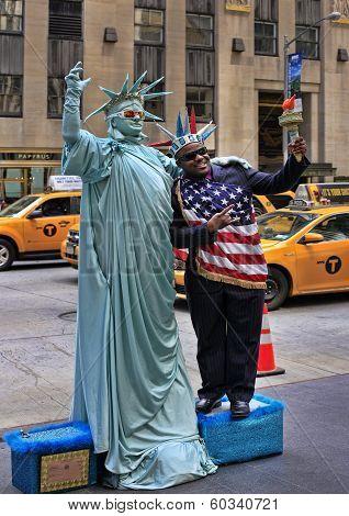 Artist Imitating Statue Of Liberty And Tourist