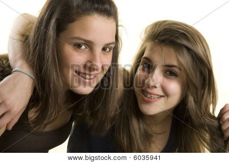 Two Girls Friends On A Studio Shot