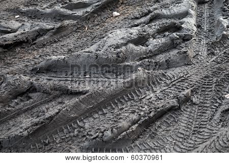 Background with dark road dirt with tire tracks poster