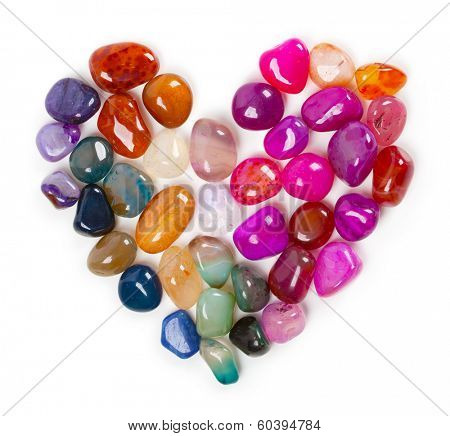 Heart of gems, Heart of stone. Colorful stones and gems arranged in a shape of a heart.