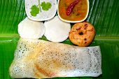South indian breakfast. Idli, dosa and vada with sambhar and chutney. poster
