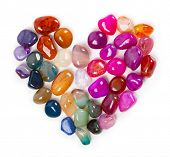 Heart of gems, Heart of stone. Colorful stones and gems arranged in a shape of a heart. poster
