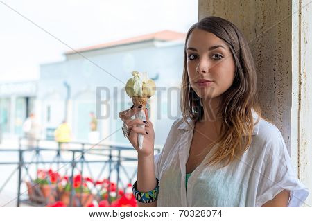 Young Girl Eating An Ice Cream Outdoor