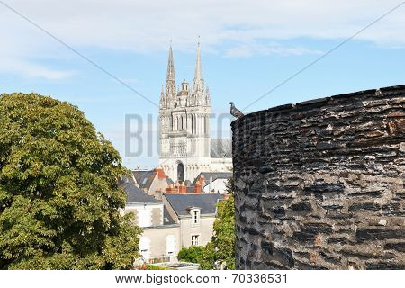 Castle Wall And Saint Maurice Cathedral In Angers