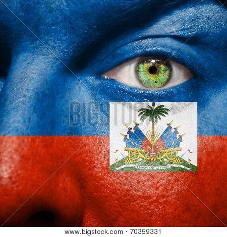 Haitian Flag Painted On A A Man's Face