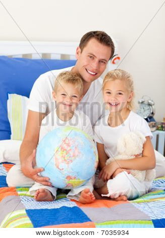 Cute Children And Their Father Looking At A Terrestrial Globe