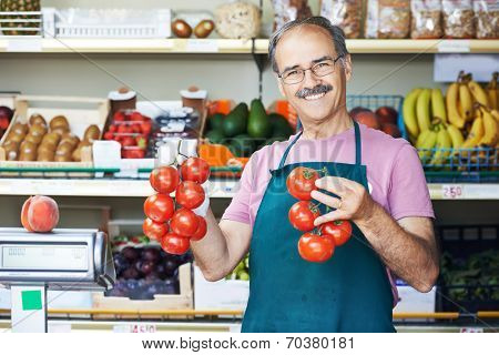 adult senior sale man with tomato at vegetable market shopping store