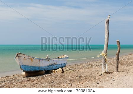 Colombia wild coastal desert of Penisula la Guajira near the Cabo de la Vela resort. The picture present traditional fishing boat. poster