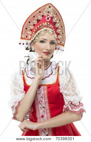 Smile coquettish young woman portrait  in russian traditional costume