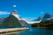 Famous Mitre Peak rising from the Milford Sound fiord. Fiordland national park, New Zealand poster