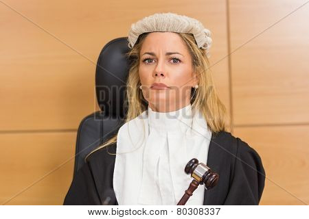 Stern judge sitting and listening in the court room