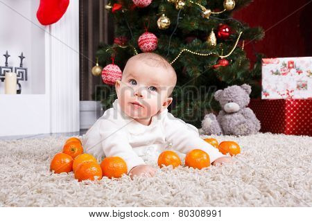 Portrait Of Baby With Tangerine