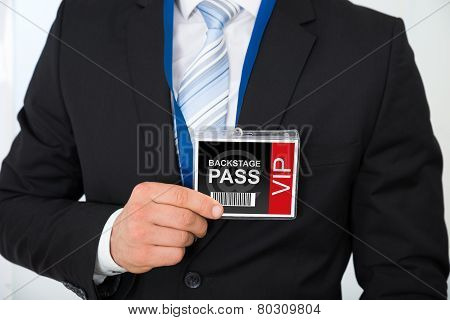 Businessman With Backstage Pass