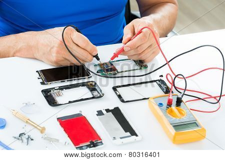 Man Repairing Cellphone