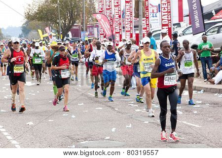 Runners Competing In The 2014 Comrades Marathon Road Race