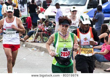 Spectators Watching The 2014 Comrades Marathon Road Race