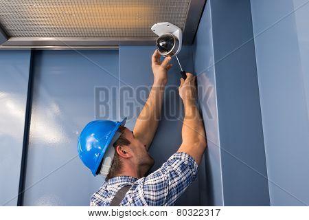 Photo Of Professional Cctv Technician Adjusting Cctv Camera poster