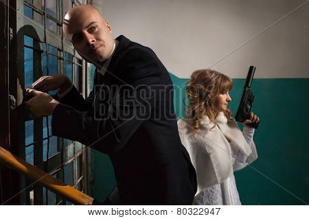 Couple Of Gangsters Is Going To Open The Door With The Master Keys.
