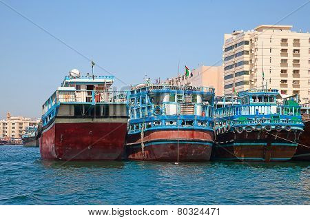 Traditional dhow ferry boats on the Dubai creek poster