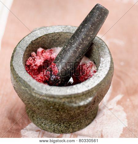 Salt and redberry marinade in granite mortar poster