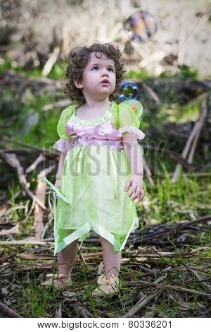Little Girl Dressed As A Fairy With Soap Bubbles