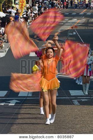 Japanese Festival Dancer Waving Flags.