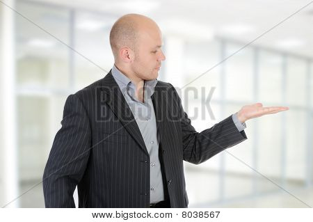 Businessman Holds His Hand Palm Up.