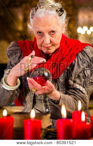 Female Fortuneteller or esoteric Oracle, sees in the future by looking into their crystal ball