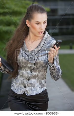 Businesswoman Looking Surprised On Cell Phone