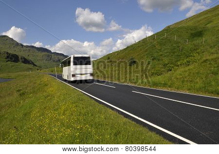 White Bus On Mountain Road