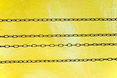 Horizontal clock chains over yellow painted wall poster