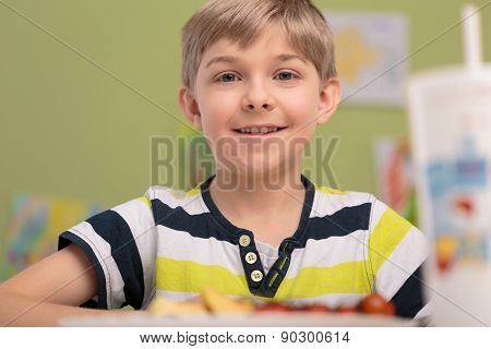 Boy Eating Breakfast In Classroom