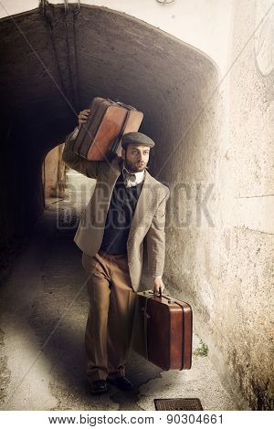 Emigrant Man With The Suitcases In A Small Town
