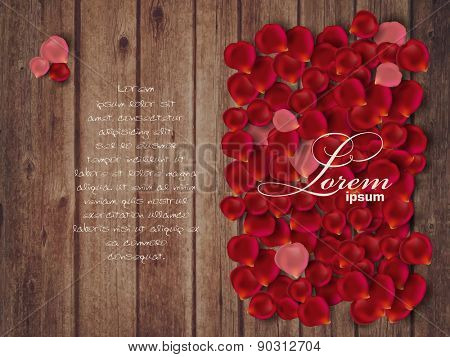 Roses  petals on wooden background with copy space. Valentine's day concept.