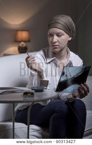 Despairing businesswoman with brain tumor smoking cigarette poster