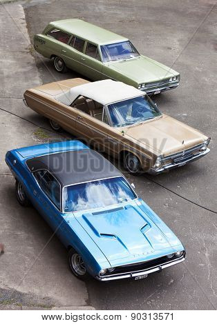 Stade, Germany - May 2, 2015: 1969 Dodge Coronet Station Wagon, 1965 Plymouth Sport Fury Convertible and 1972 Dodge Charger at Spring Fling, annual meeting for vintage cars built by Chrysler Corp.