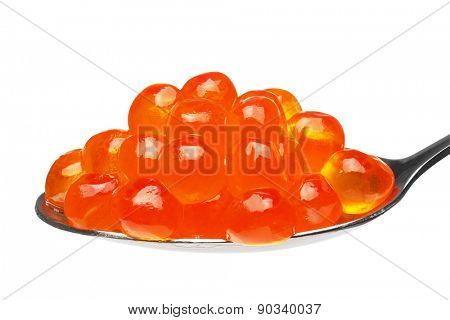 Close-up of red caviar in a teaspoon, isolated on the white background, clipping path included.