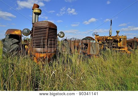 Old rusty tractor in the the long grass