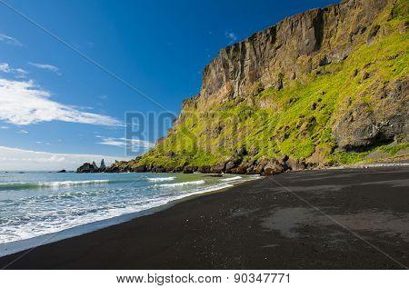Panoramic photo of a black sandy beach at Vik, Iceland