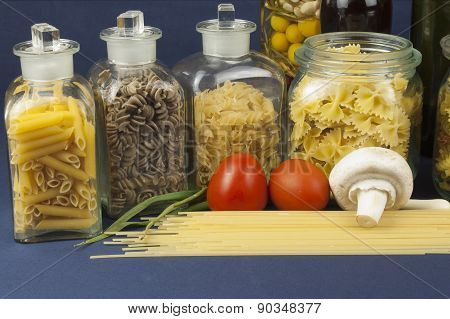 Various types of pasta on the table, homemade food preparation
