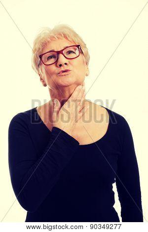 Senior woman suffering from throat pain