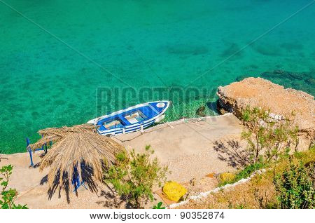 Small motorbat docked in peaceful bay