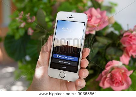 Woman Holding Iphone 5S With Instagram On The Screen