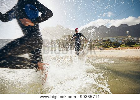 Athletes Training For A Triathlon