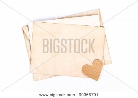 vintage envelope with paper heart isolated on white background