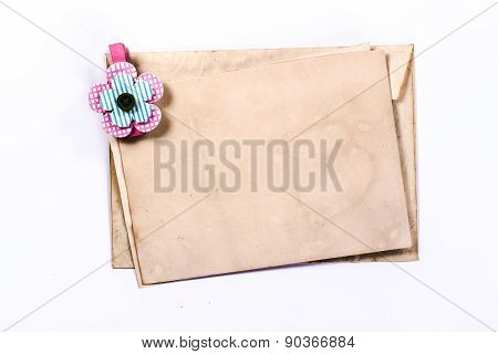 isolated old yellow envelope with clothespin.