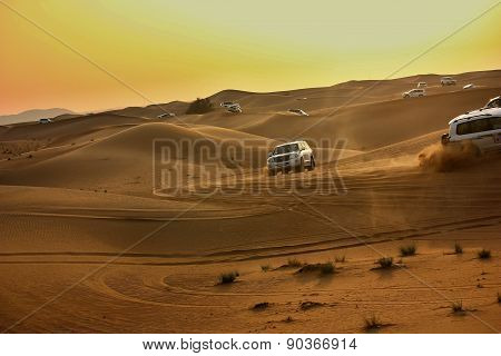 Driving on jeeps on the desert
