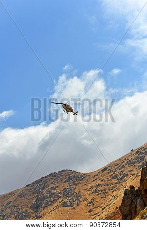 Helicopter in Mountains
