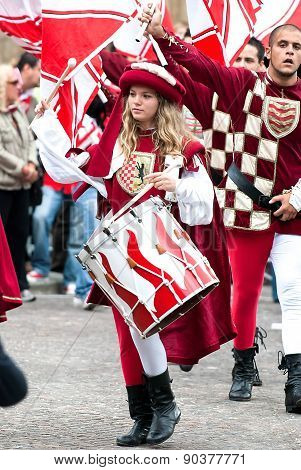 Young Girl Drummer In Medieval Reenactment Costumes